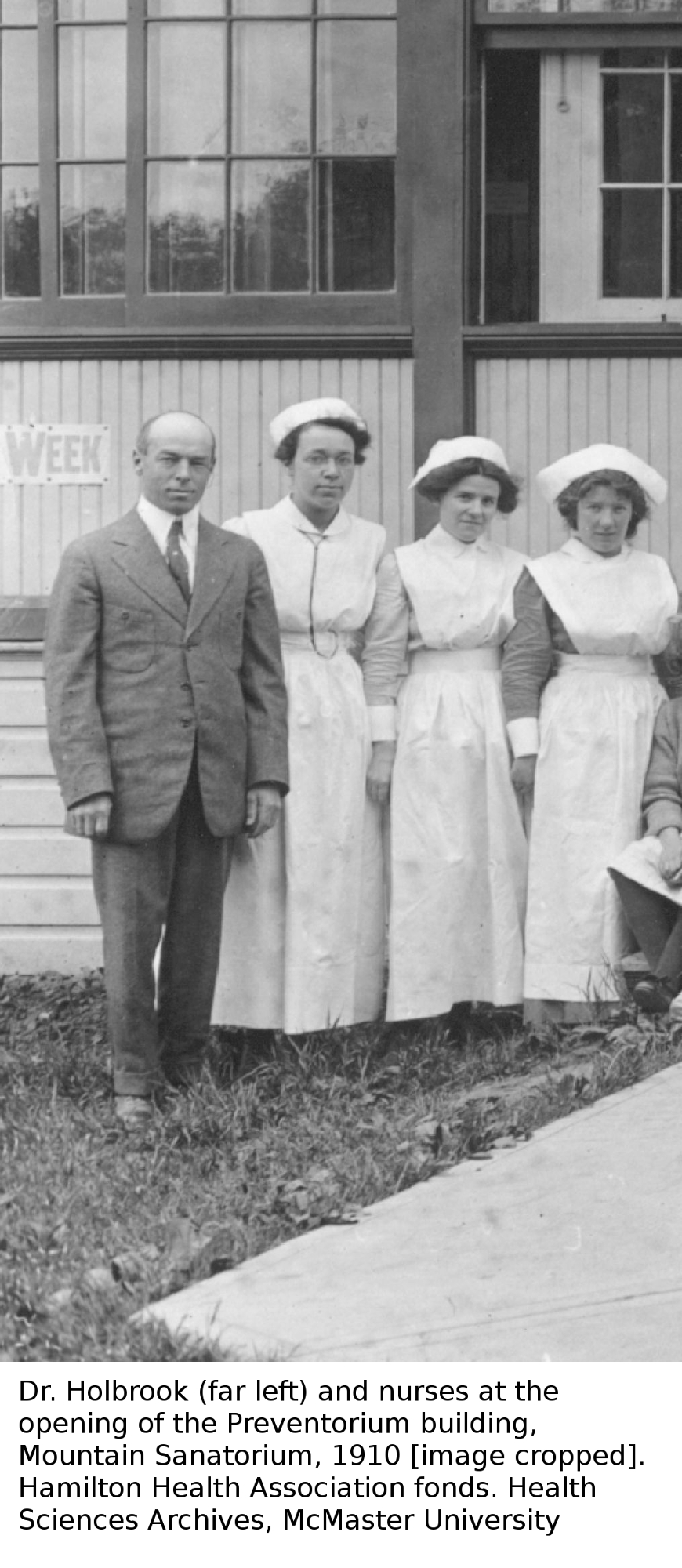 Black and white image of Dr. Holbrook (far left) and nurses at the opening of the Preventorium building, Mountain Sanatorium, 1910 [image cropped]
