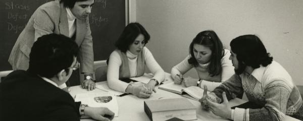A group of students study in the library's group study rooms