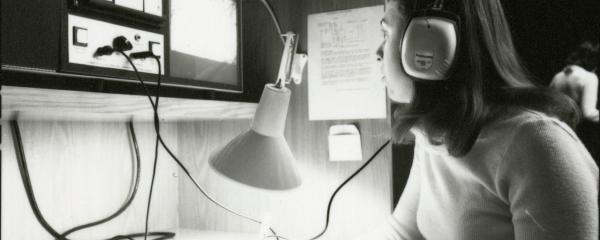 A student using audiovisual equipment in a study carrel in the Health Sciences Library